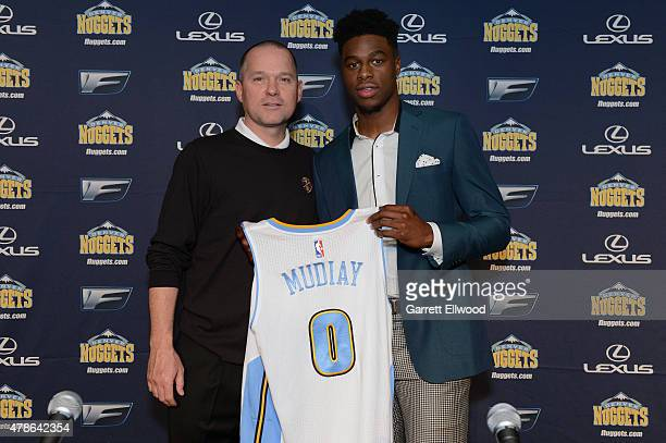 The seventh selection in the 2015 NBA Draft Emmanuel Mudiay and Head Coach Mike Malone of the Denver Nuggets pose for a photo during a press...