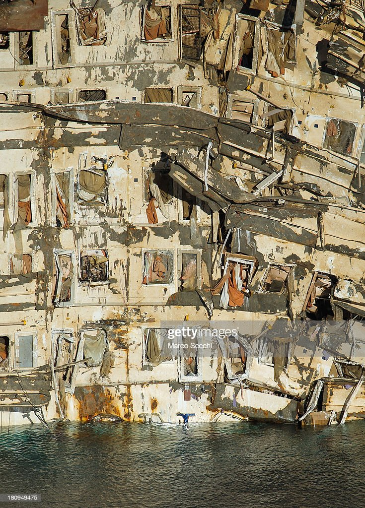 The severely damaged right side of the Costa Concordia is seen on September 18, 2013 in Isola del Giglio, Italy. The vessel, which sank on January 12, 2012, was successfully righted during a painstaking operation yesterday morning. The ship will eventually be towed away and scrapped. It was the first time the procedure, known as parbuckling, had been carried out on a vessel as large as Costa Concordia.