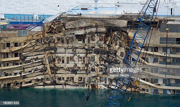 The severely damaged side of the stricken Costa Concordia is visible after the parbuckling operation succesfully uprighted the ship around 4 am on...
