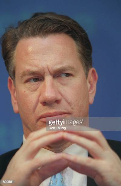 The Shadow Chancellor of the Exchequer Michael Portillo listens at a press conference at the Conservative Central Office April 11 2001 in London...