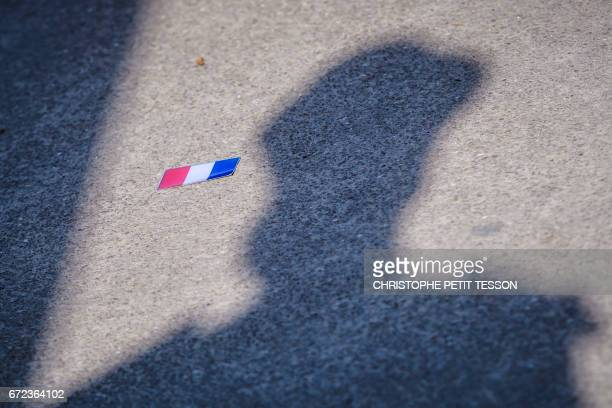 The shadow of a French Republican guard is seen on the floor next to a French national flag during a ceremony marking the 102nd anniversary of the...