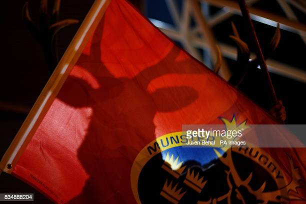 The shadow of a Munster fan is shown against a flag before kickoff at Thomond Park Limerick