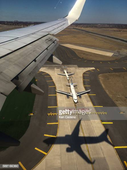The shadow of a plane is seen on the taxiway coming into JFK International airport Jamaica Bay Queens Co New York City Monday March 24 2014 Photo Ken...