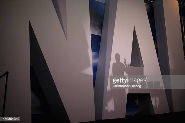 The shadow of a speaker falls on a giant 'NAI' backdrop as supporters of the 'Yes' campaign attend a rally and listen to speeches at the Olympic...