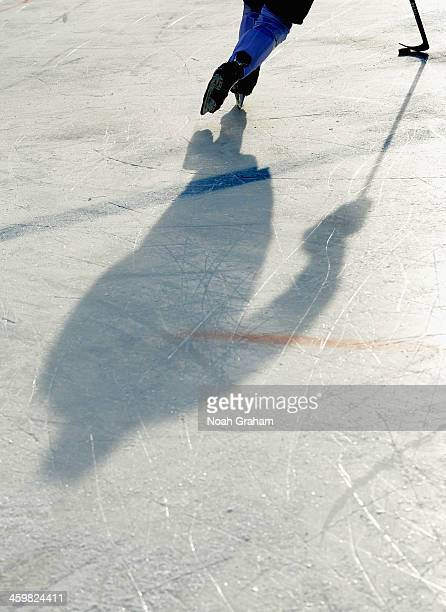 The shadow of a Toronto Maple Leafs player is seen on the ice as he skates during the 2014 Bridgestone NHL Winter Classic team practice session on...