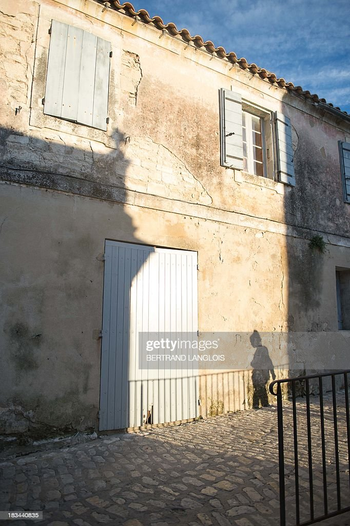 The shadow of a woman is seen on a wall, on October 2, 2013 at the village of Baux-de-Provence, classified as one of the Most beautiful Villages in France.