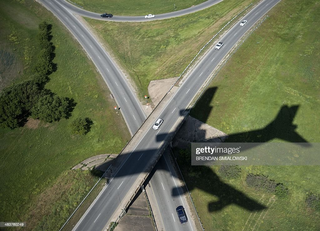 The shadow of Air Force One is seen as US President Barack Obama arrives at Austin-Bergstrom International Airport April 10, 2014 in Austin, Texas. Obama is in Austin to visit the Lyndon B. Johnson Presidential Library and speak during a Civil Rights Summit. AFP PHOTO/Brendan SMIALOWSKI