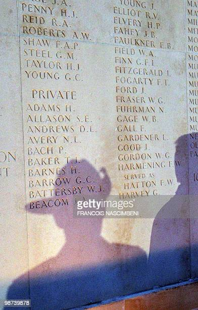 The shadow of Australians soldiers are cast on a memorial wall as they attend a dawn service commemorating Anzac Day on the WWI battlefield of...