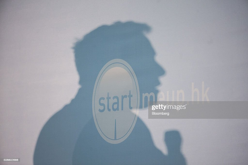 The shadow of billionaire Elon Musk, chief executive officer of Tesla Motors Inc., is cast on a wall as he speaks during the StartmeupHK Venture Forum in Hong Kong, China, on Tuesday, Jan. 26, 2016. Tesla is looking for a Chinese production partner but is 'still trying to figure that out,' Musk said. Photographer: Justin Chin/Bloomberg via Getty Images