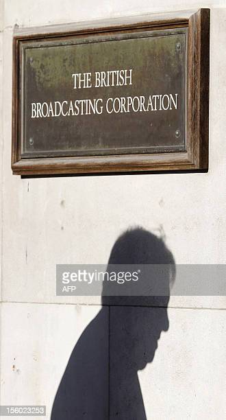 The shadow of chairman of the BBC Trust Lord Chris Patten is reflected on a wall outside the BBC's offices in central London on November 11 2012...