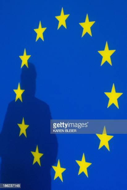 The shadow of Claude Moraes European Union's leader for the parliamentary inquiry on mass surveillance as he addresses reporters during a press...