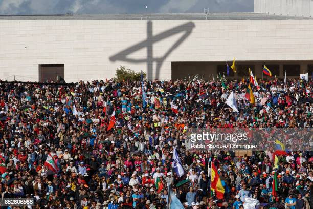 The shadow of cross is seen on a wall as crowds of worshippers wait for the arrival start of the ceremony of canonization at the Sanctuary of Fatima...