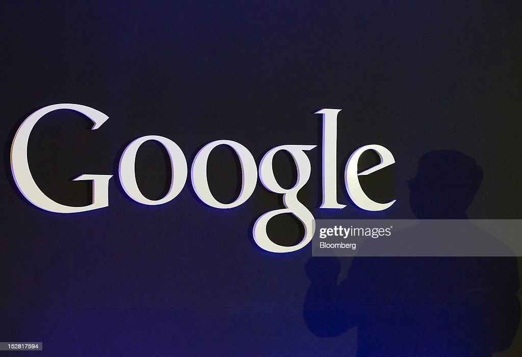 The shadow of Eric Schmidt, executive chairman of Google Inc., is cast beside the company's logo at a news conference in Seoul, South Korea, on Thursday, Sept. 27, 2012. Google Inc. will start selling its Nexus 7 tablet in South Korea on Oct. 7 to meet demand for mobile devices on the home turf of Samsung Electronics Co., the world's biggest seller of smartphones. Photographer: SeongJoon Cho/Bloomberg via Getty Images