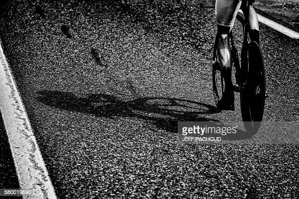 The shadow of Great Britain's Christopher Froome riding is pictured during the 17 km individual timetrial the eighteenth stage of the 103rd edition...