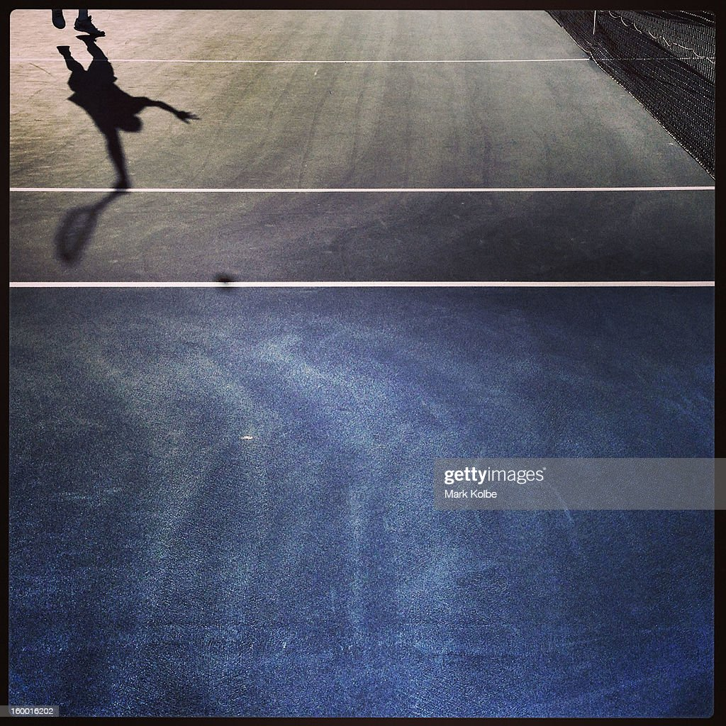 The shadow of Guillermo Garcia-Lopez of Spain is seen as he serves in his first round match against Rajeev Ram of the United States of America during day two of the 2013 Australian Open at Melbourne Park on January 15, 2013 in Melbourne, Australia.