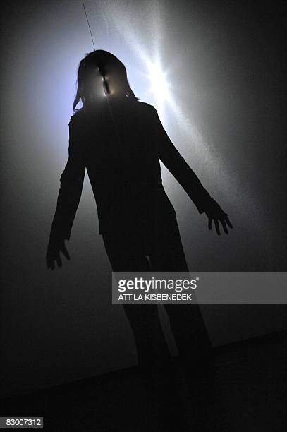 The shadow of JapaneseFrench Compagnie Oki Haiku Dan's dancer Keisuke Kana is seen as he performs his dance on the stage of the ''TRAFO' contemporary...