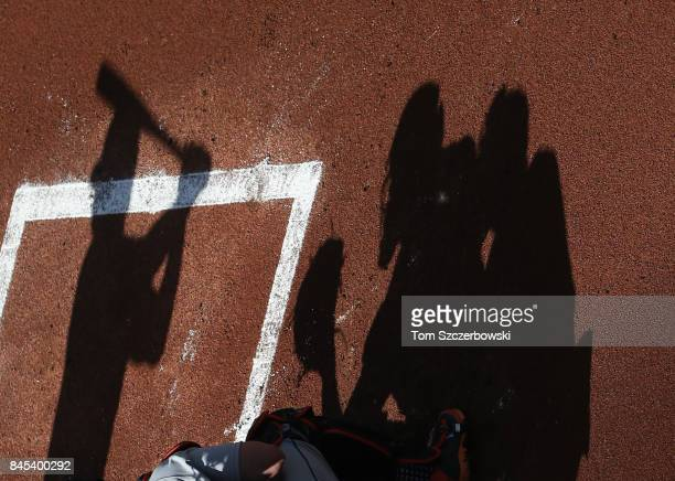 The shadow of Justin Smoak of the Toronto Blue Jays as he bats in the first inning during MLB game action and as James McCann of the Detroit Tigers...