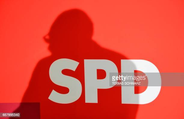 The shadow of Martin Schulz candidate for Chancellor of Germany's Social Democratic Party is seen as he addresses supporters after exit poll results...