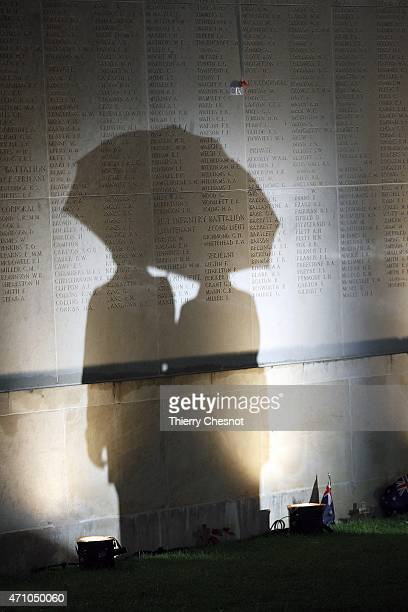 The shadow of people attending a dawn service to commemorate the 100th anniversary of the Anzac Day at the Australian War Memorial falls on the...