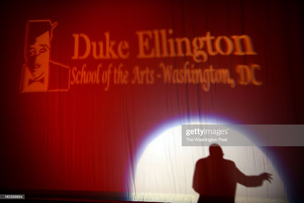 The shadow of Rory Pullens, head of school of the Duke Ellington School of the Arts, is seen during his opening remarks for a performance of playwright Janet Langhart Cohen's dramatic reading and one-act play, 'Anne & Emmett'. 'Anne & Emmett' is an imaginary conversation between Anne Frank and Emmett Till. Frank recounts her experience in the Holocaust, and Till his tragic tale of racial hatred and violence in the American South. They then share in the search for reconciliation and hope in this unforgettable work. Janet Langhart Cohen, wife of former Secretary of Defense William S. Cohen, is an author, playwright , Emmy nominated broadcast journalist, and advocate for human rights. Students reading the play are Sarah Hirsch, Devin Re, Kim Bey, Elijah Lawrence..