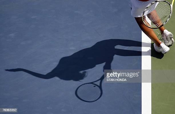 The shadow of Sania Mirza of India on the court as she serves to Kaia Kanepi of Estonia during the first round of the US Open Tennis Championship 28...