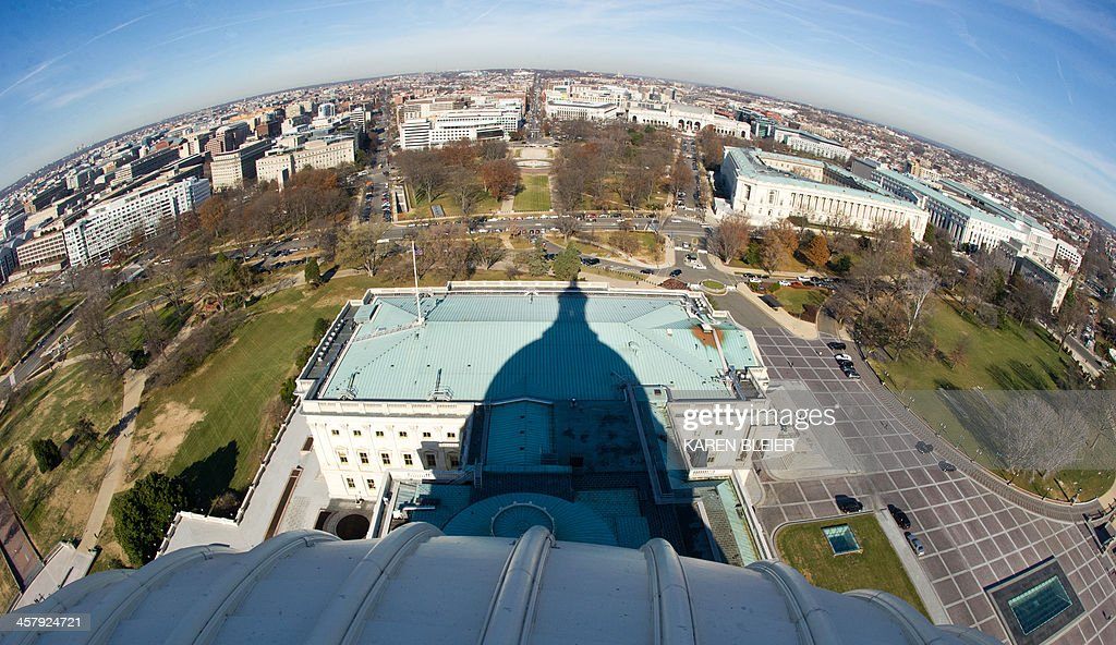The shadow of the of the US Capitol dome is seen during a tour of the dome December 19, 2013 in Washington, DC. The Dome has not undergone a complete restoration since 1959-1960 and due to age and weather is now plagued by more than 1,000 cracks and deficiencies. The Architect of the Capitol began in November, a multi-year project to repair these deficiencies, restoring the Dome to its original, inspiring splendor. AFP PHOTO / Karen BLEIER
