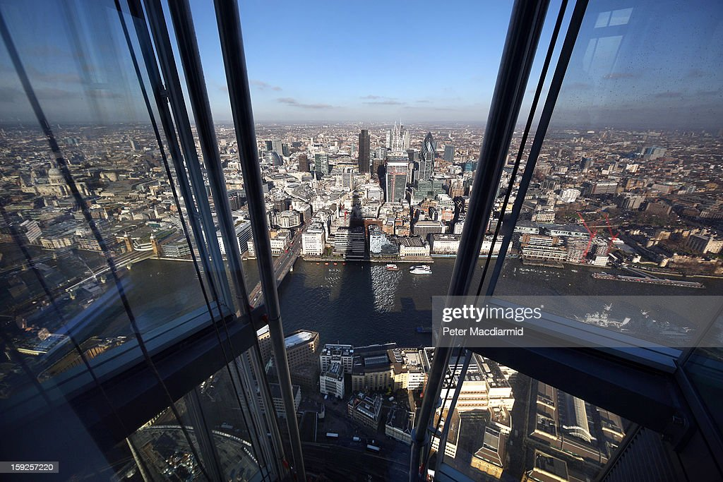 The shadow of the Shard falls over the River Thames and The City of London financial district, as seen from the Shard's viewing platform on January 9, 2013 in London, England. Standing at 309.6 metres (1,016 ft) high, the Shard is open to the public from February 1, 2013, with visitors paying 24.95 GBP to enjoy views of London. The 95-storey skycraper, which will be surpassed by the still under construction Mercury City Tower in Moscow as the tallest building in Europe, was designed by Italian architect Renzo Piano and was topped out on March 30, 2012.