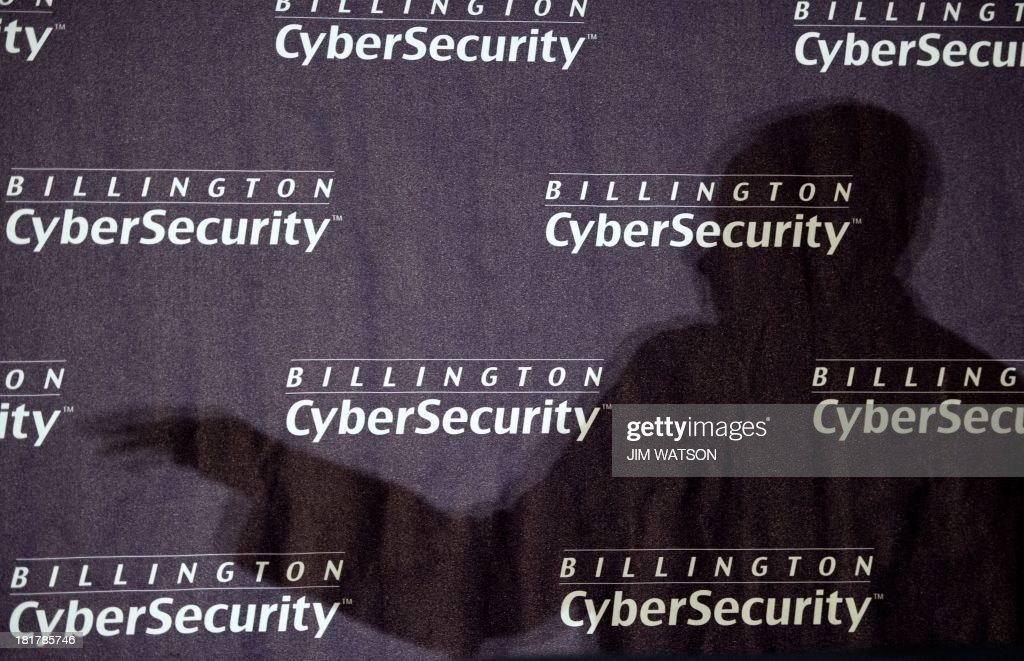 The shadow of US Army Gen. Keith Alexander, commander of US Cyber Command and director of the National Security Agency (NSA), is seen as he delivers opening keynote remarks September 25, 2013 during the fourth annual Cybersecurity Summit held in Washington, DC. The leader of the embattled National Security Agency doubled down Wednesday against calls from Capitol Hill to restrict US government surveillance programs a campaign he attributed to sensationalized reporting and media leaks. Alexander instead emphasized the NSA isnt listening to Americans phone calls and reading their emails, and he urged technology and government leaders at the conference to help get the facts out and get our nation to understand why we need these tools in the wake of Edward Snowdens disclosures. AFP PHOTO / Jim WATSON