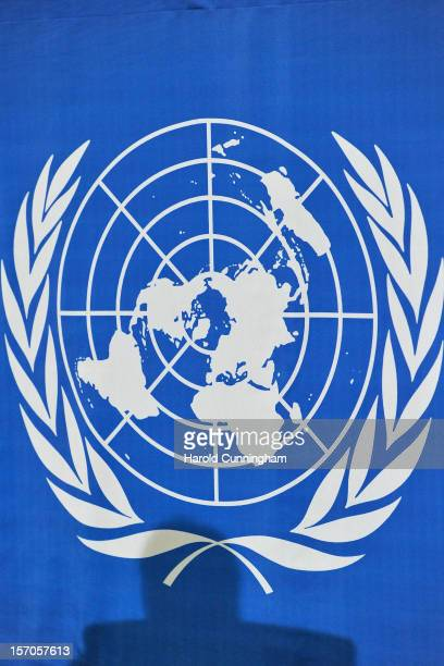 The shadow of World Meteorological Organization Secretary General Michel Jarraud is seen on the United Nations logo as he comments on the state of...