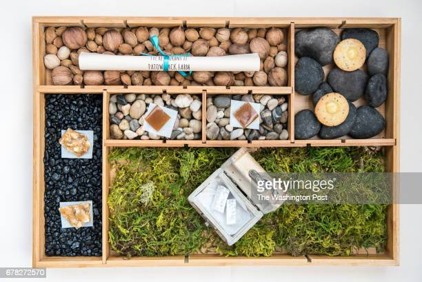 The shadowbox of sweet bites salted black walnut brittle chia seed cookies with myer lemon curd black dog coffee Turkish delight sassafras root candy...