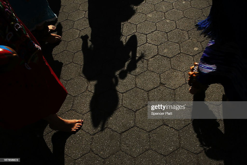 The shadows and feet of members of a Mexica indigenous dance group perform a ritual dance before the start of a International Workers Day, or Labor Day, march May 1, 2013 in New York City. The annual gathering of activists, leftists, labor unions and others often results in confrontations with police. The very first Labor Day in America took place on May 1, 1886, as a celebration of the American labor movement and the adoption of the 8-hour work day.