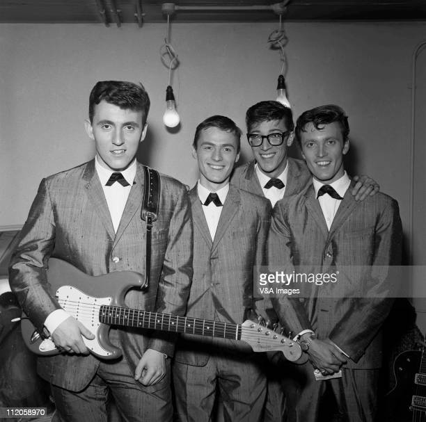 The Shadows Bruce Welch Tony Meehan Hank Marvin Jet Harris posed group shot 1960 Bruce Welch holds a Fender Stratocaster guitar