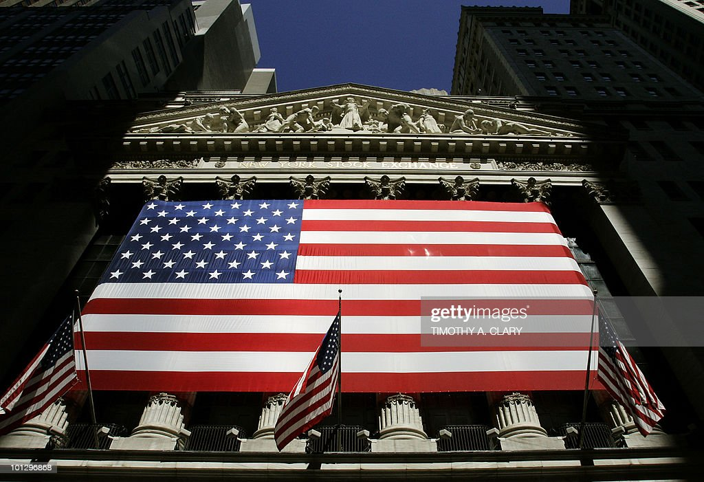The shadows from the morning light fall on the front of the New York Stock Exchange 21 June 2007 in New York City Stocks were up slightly as they...
