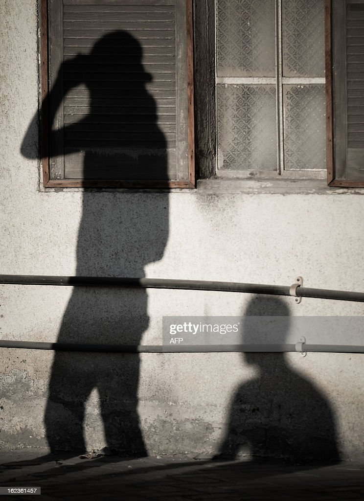 The shadows of Bahraini protestors, are seen on a wall during clashes with riot police following an anti-regime demonstration against the killing of 20-year old Mahmud al-Jaziri, in the village of Daih, West of Manama, on February 22, 2013. The Shiite protester died of wounds after he was shot during clashes with Bahraini police on the second anniversary of the February 14, 2011 uprising.