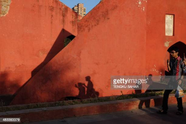 The shadows of Indian visitors are cast onto a structure at Jantar Mantar in New Delhi on April 8 2014 The Jantar Mantar site in New Delhi which...