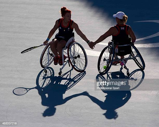 The shadows of Jordanne Whiley with partner Lucy Shuker of Great Britain during their match against Sakhorn Khanthasit and Ratana Techamaneewat of...