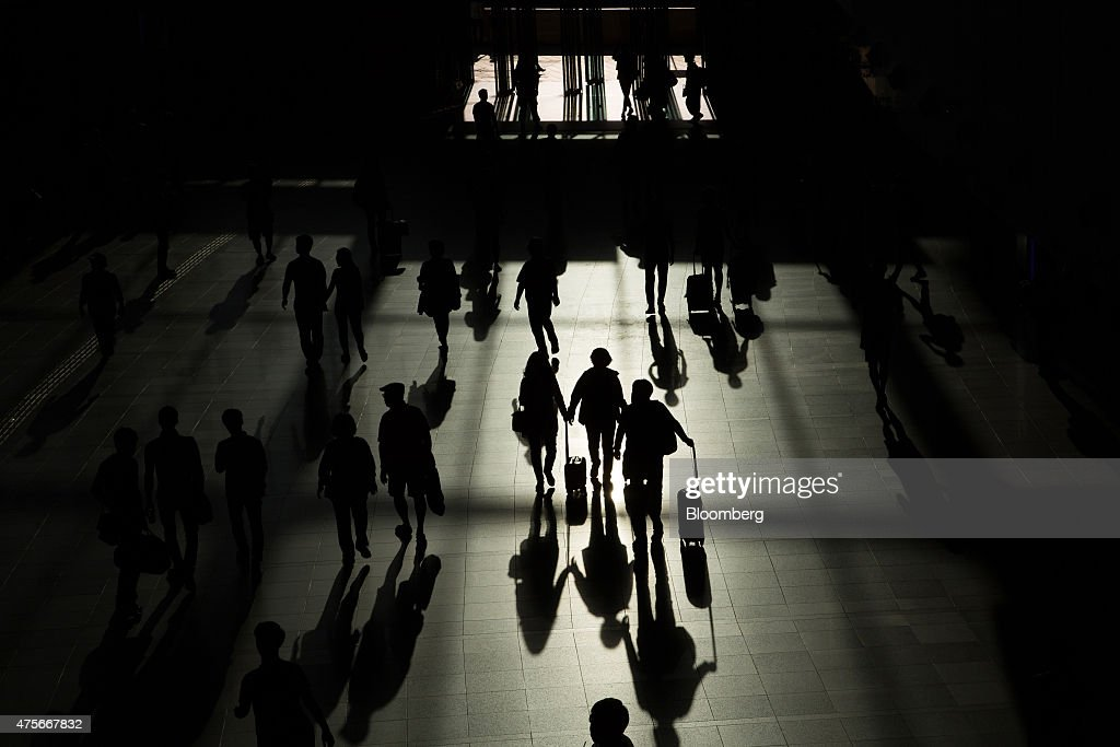 The shadows of passengers holding their luggage are cast on the floor as they walk through Seoul Station in Seoul South Korea on Monday May 25 2015...