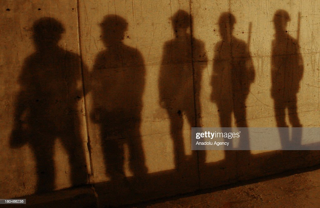 The shadows of the subway workers on the wall of the subway tunnel on August 12, 2012 in Ankara. Three new lines are being added to Anakara's Subway system to be completed by June 2014.