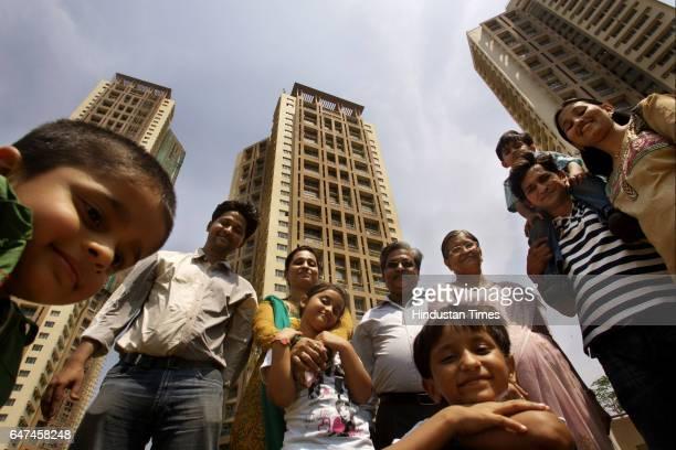 The Shah family Vidyut Smita Mukesh Poornima Harshit and Manali with kids Prem Sania Samay and Partha outside Ashok Towers Parel