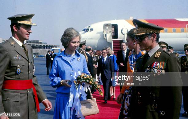 The Shah of Iran Mohammad Reza Pahlavi and his wife Farah Diba received at the airport the Spanish Kings Juan Carlos and Sofia in official visit...
