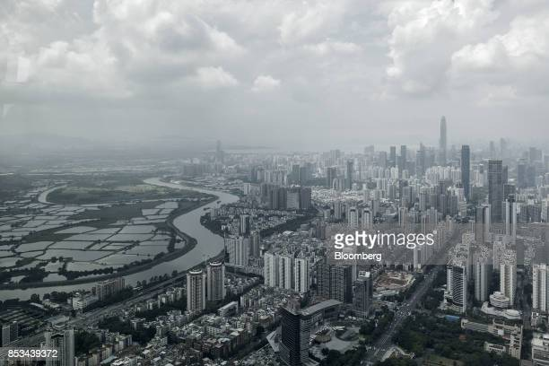 The Sham Chun river marking the border between residential and commercial buildings in mainland China right and farmland in Hong Kong is seen from...