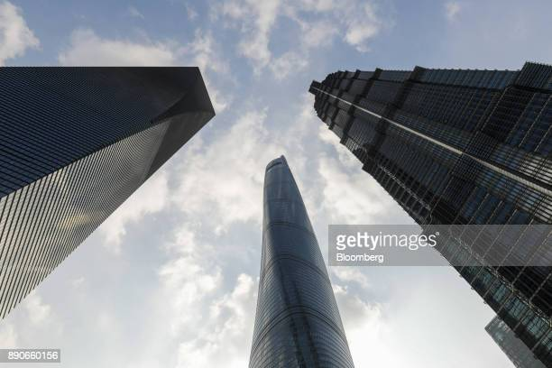 The Shanghai Tower center stands next to the Shanghai World Financial Center left and the Jinmao Tower right in Shanghai China on Friday Dec 1 2017...