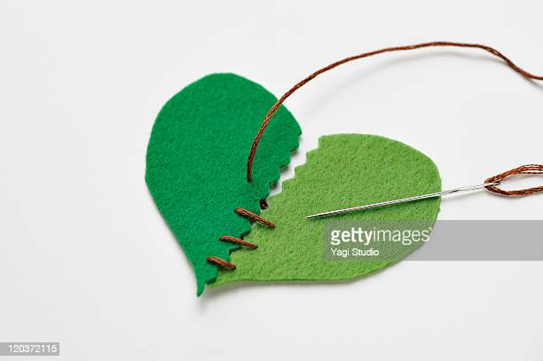 The shape of the heart , it is being sewn with a t