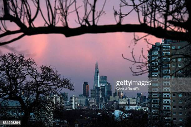 The Shard Gherkin and other skyscrapers are seen in the distance from Brockwell Park as the sun rises on January 13 2017 in London United Kingdom The...