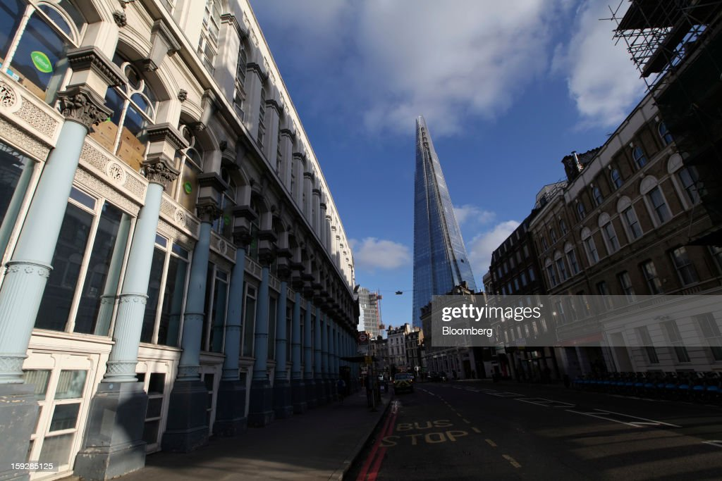 The Shard tower, center, stands above rows of period houses and offices in London, U.K., on Wednesday, Jan. 9, 2013. The Shard, which stands at 309.6 meters on London's South Bank, is owned by LBQ Ltd., which brings together the State of Qatar (the majority shareholder) and Sellar Property Group Ltd., with non-equity funding by Qatar National Bank. Photographer: Chris Ratcliffe/Bloomberg via Getty Images