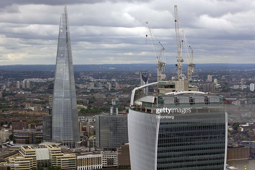 The Shard tower, left, and 20 Fenchurch Street, also known as the 'Walkie-Talkie', are seen from the top of the Swiss Re building, also known as the 'Gherkin', in London, U.K., on Sunday, June 23, 2013. U.K. commercial real estate values rose for the first time in 18 months in May, led by increasing demand for offices, Investment Property Databank Ltd. said. Photographer: Jason Alden/Bloomberg via Getty Images
