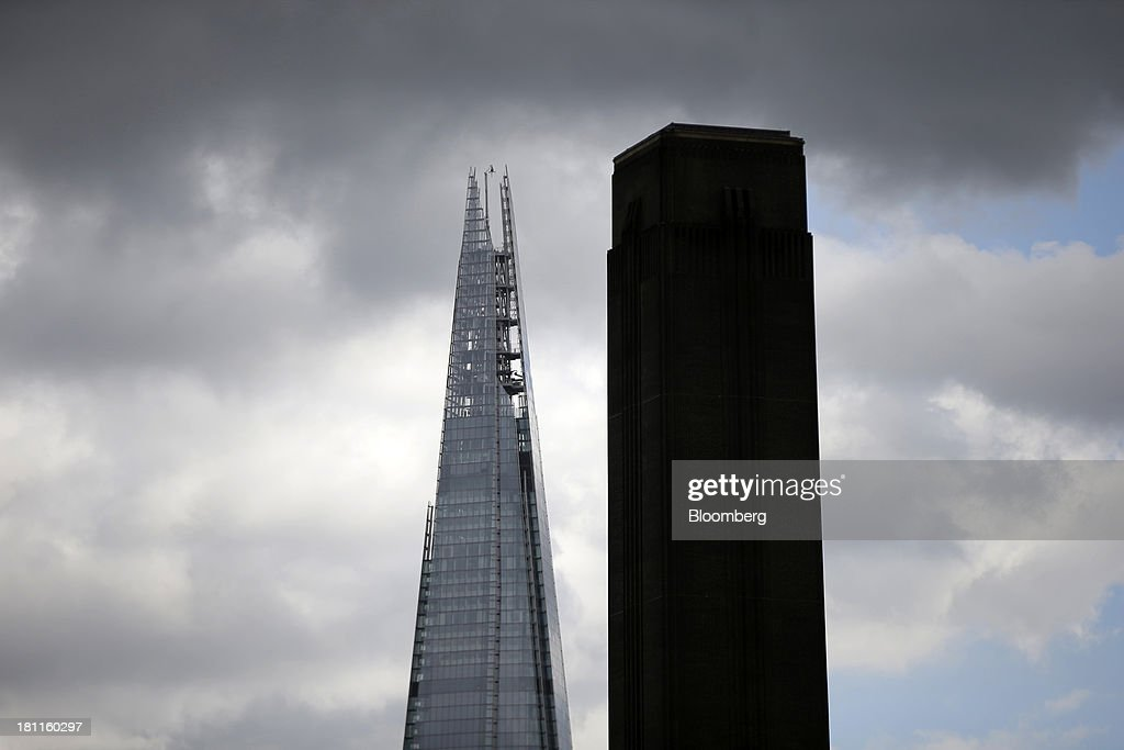 The Shard tower skyscraper, left, stands beside the chimney tower of Tate Modern art gallery in London, U.K., on Wednesday, Sept. 18, 2013. U.K. commercial real estate values rose for the fourth straight month in August, led by office buildings and warehouses, Investment Property Databank Ltd. said. Photographer: Matthew Lloyd/Bloomberg via Getty Images