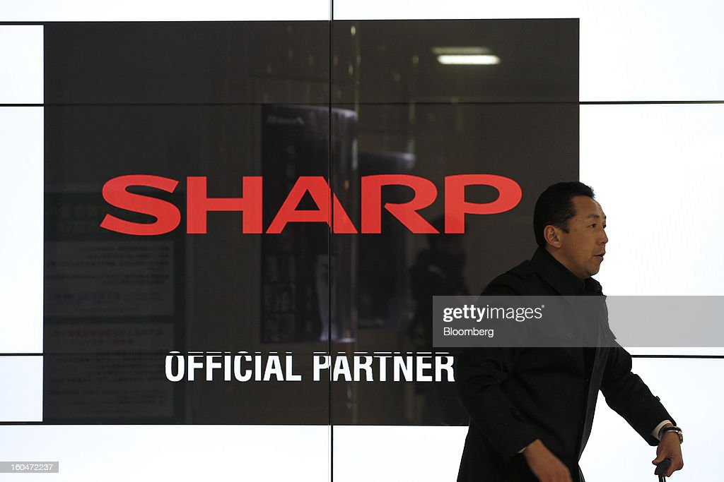 The Sharp Corp. logo sits on a LCD display in Tokyo, Japan, on Friday, Feb. 1, 2013. Sharp Corp., the Japanese TV-maker that has warned about its ability to survive, posted a narrower loss helped by job cuts asset sales and a weaker yen. Photographer: Kiyoshi Ota/Bloomberg via Getty Images