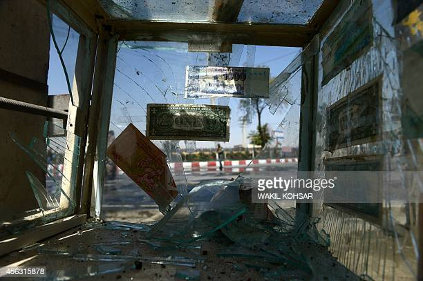 The shattered glass of a foreign currency exchange vendor's box is pictured at the scene of a suicide attack near the international airport in Kabul...