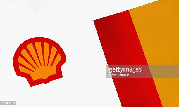 The Shell logo is shown on a petrol pump at a Shell petrol station April 23 2003 in London England Shell is facing a shareholder revolt over...